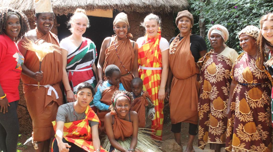A group of teenage volunteers doing a care internship in Kenya with Projects Abroad experience local culture.